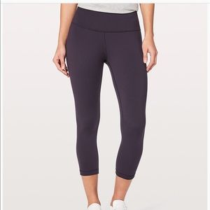 Size two turquoise Lululemon low-rise leggings